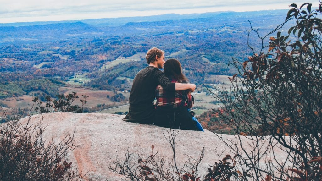 young couple at a mountain lookout