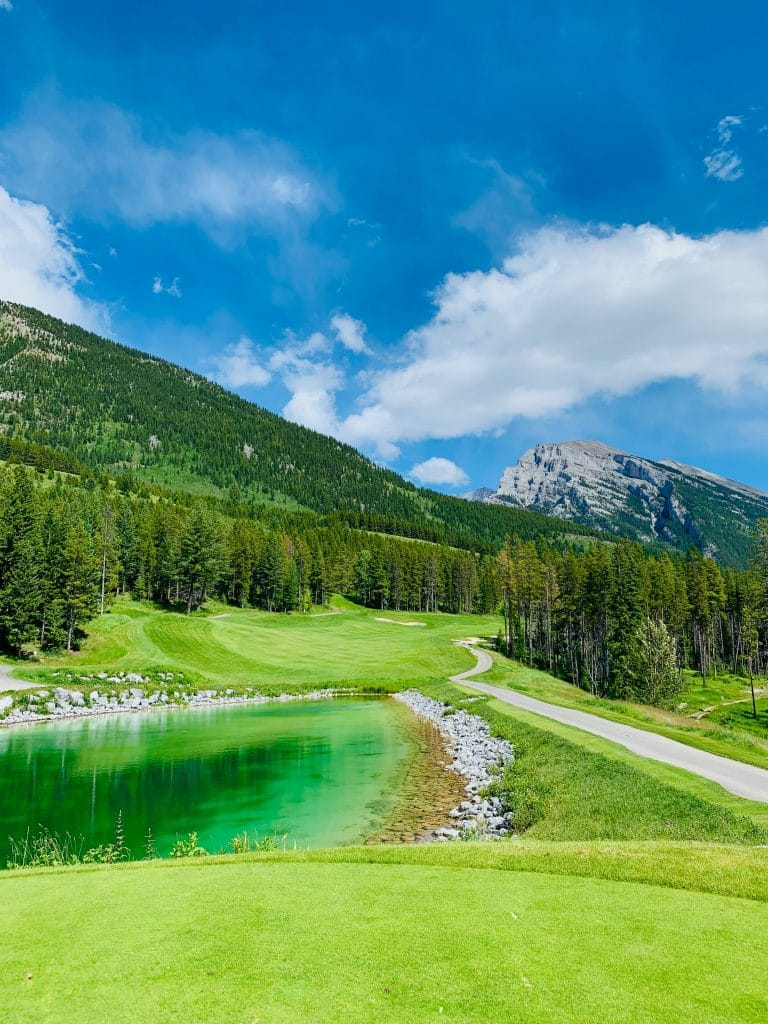 golf course green with blue ski