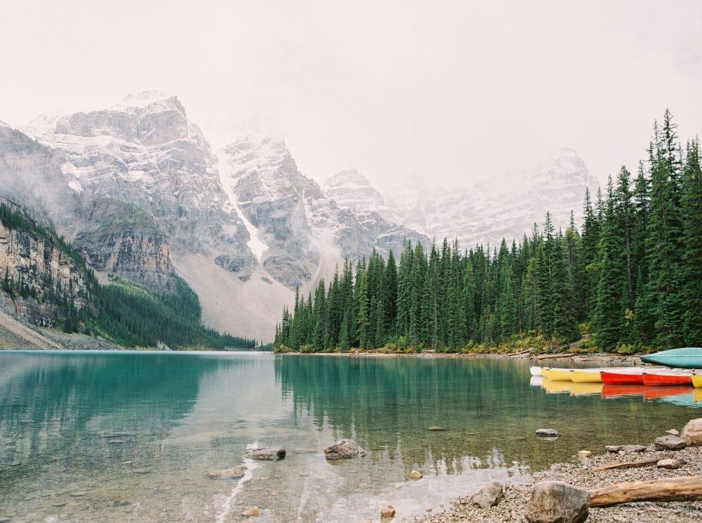 canoes on a beautiful mountain lake